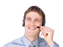 Assertive businessmnan with headset on looking up Royalty Free Stock Image