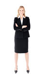 Assertive businesswoman with folded arms smiling Stock Photography