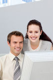 Assertive businesswoman helping her colleague Stock Images