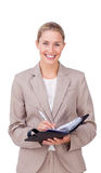 Assertive businesswoman making notes on her agenda Royalty Free Stock Photography
