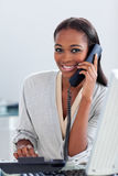 Assertive businesswoman on phone Royalty Free Stock Image