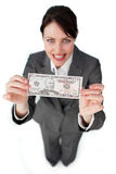 Assertive businesswoman showing a bank note Stock Image
