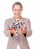 Assertive businesswoman showing a molecule Stock Photo