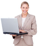 Assertive businesswoman using a laptop Stock Images