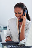 Assertive ethnic businesswoman talking on a phone Stock Images
