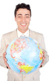Assertive executive holding a terrestrial globe. Assertive male executive holding a terrestrial globe isolated on a white background royalty free stock images