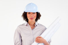 Assertive female architect with blueprints. Against white background Royalty Free Stock Photo