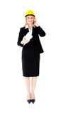 Assertive female architecture with a hat phoning Royalty Free Stock Image