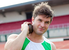Assertive male athlete preparing to throw weight Royalty Free Stock Photos