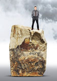 Assertive man stands on the top of a rock Royalty Free Stock Images