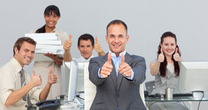 Assertive manager and his team with thumbs up Royalty Free Stock Photos