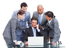 Assertive manager on phone and his team Royalty Free Stock Photography