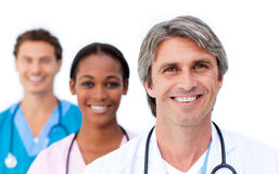 Assertive medical team standing Stock Image
