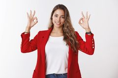 Assertive skillfull confident young female feeling lucky totally sure everything alright, showing okay ok gesture. Smiling self-assured encouraged get promotion stock photography