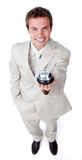 Assertive young businessman holding a service bell. Against a white background Stock Images