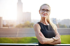 Assertiveness first. Close up portrait of very self-confident businesswoman with cityscape in background stock photo