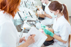 Assesing their skills in cavity treatment stock photography