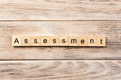 Assessment word written on wood block. assessment text on table, concept.  stock images