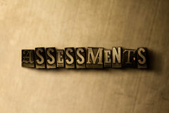ASSESSMENTS - close-up of grungy vintage typeset word on metal backdrop Stock Photography