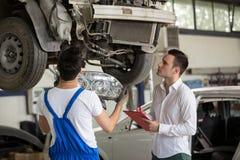 Assessor analyzing damage crash car Stock Images