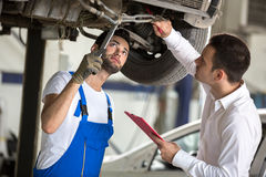 Assessor and repair man examine car Stock Photo