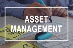 Asset management concept. Financial report on the desk. Asset management concept. Financial report on a desk royalty free stock image