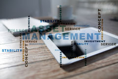 Asset management on the virtual screen. Business concept. Words cloud. Stock Photography