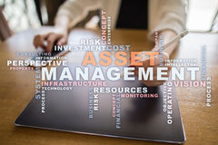 Asset management on the virtual screen. Business concept. Words cloud. Stock Image