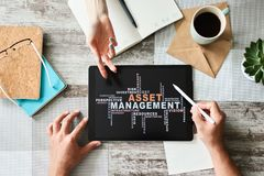 Asset management words cloud on screen. FInancial and Business concept. royalty free stock images