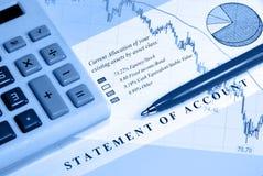 Asset Statement in Blue Mood. Asset statement, declining graph line, calculator, and pen Stock Photos