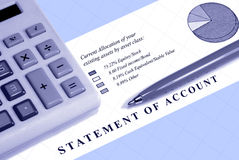 Asset Statement With Down Graph. Asset statement, declining graph line, calculator, and pen Stock Images