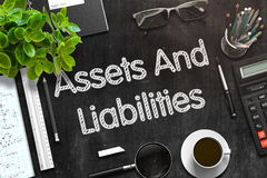 Assets And Liabilities on Black Chalkboard. 3D Rendering. Stock Photography