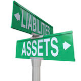 Assets Vs Liabilities Two Way Road Street Signs Accounting. Assets and Liabilities words on green two way street or road signs to illustrate the balance between vector illustration