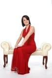 Assez de l'adolescence dans la robe rouge Image stock