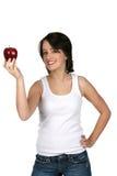 Assez de l'adolescence offrant une pomme rouge Photographie stock libre de droits