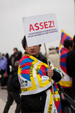 Assez! (Enough!). Protesters against China's occupation in Tibet. Paris, France. Lhasa events' anniversary, March 10th, 2012 Stock Photo