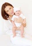 Assez femelle avec le bébé Image libre de droits