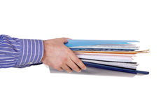 Assigning paperwork. Hands with files and folders on white stock photos