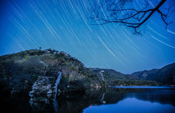 For assignment files Startrails over Great Wall. The stars full of the sky over Great Wall were shining brightly,when I climbed up the mountains near Beijing stock images