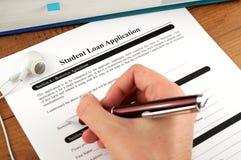 Assinatura da aplicação de empréstimo do estudante Fotografia de Stock