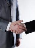 Assinatura do acordo e de um aperto de mão Imagem de Stock