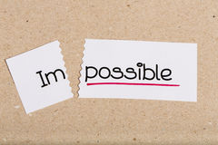 Assine com o impossível da palavra transformado em possível Foto de Stock Royalty Free