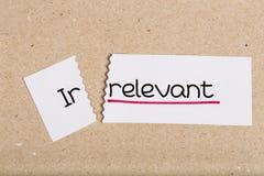 Assine com o irrelvant da palavra transformado em relevante Fotografia de Stock