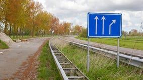 Assine em uma estrada abandonada nos Países Baixos Foto de Stock Royalty Free