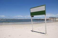 Assine em uma praia Imagens de Stock Royalty Free