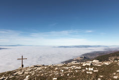 Assisi, cross and fog Royalty Free Stock Image