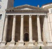 Assisi, Italia, un patrimonio mundial de la UNESCO El templo de Minerva localizó en el centro de ciudad Imagen de archivo libre de regalías