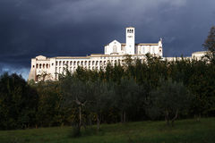 Assisi, Italy, Basilica of St. Francis with storm. Seen by the lower part Stock Photos