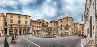 Panoramic view of Piazza del Comune, main square, Assisi, Italy Stock Photos