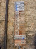 Assisi, Italy. A large number of small-scale signs showing the direction of the various monuments and main services royalty free stock photography